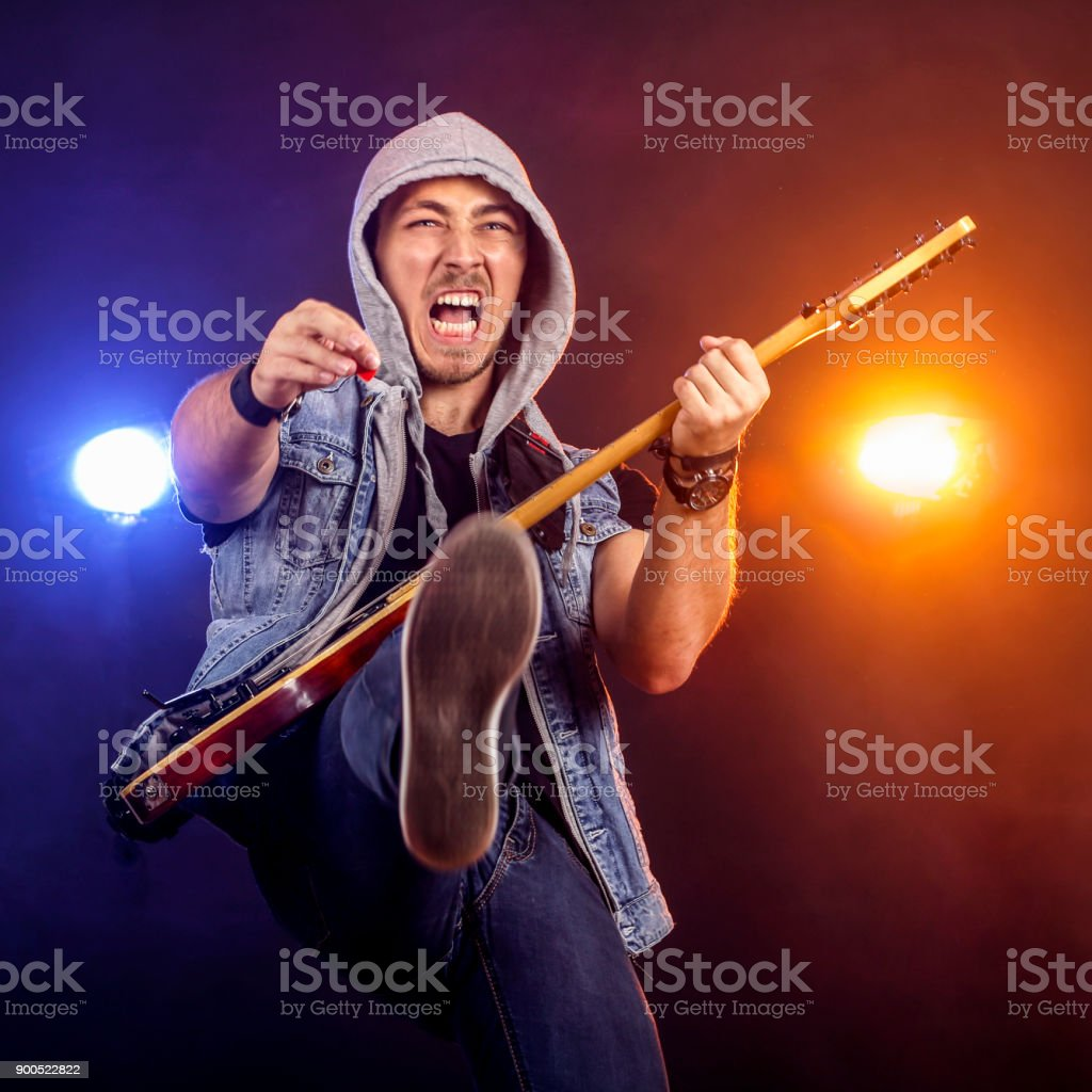 Ecstatic guitarist on stage stock photo