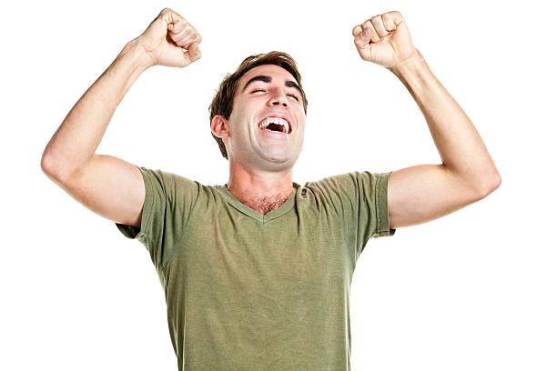 ecstatic happy man cheering and shaking fists - korte mouwen stockfoto's en -beelden