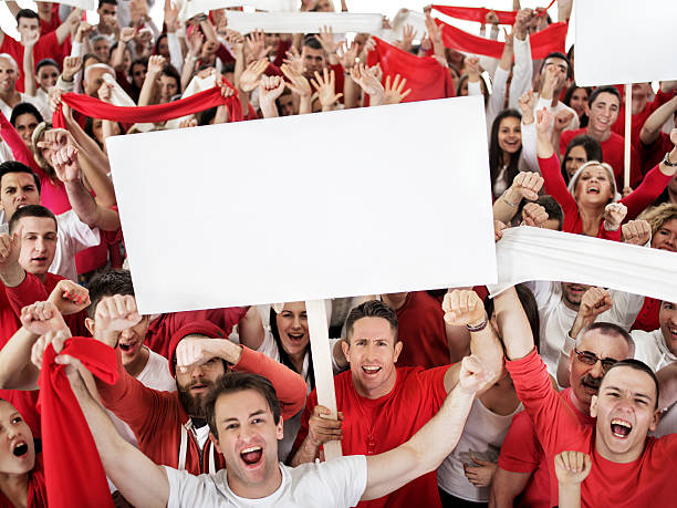 Ecstatic large group of sport fans shouting and cheering. stock photo