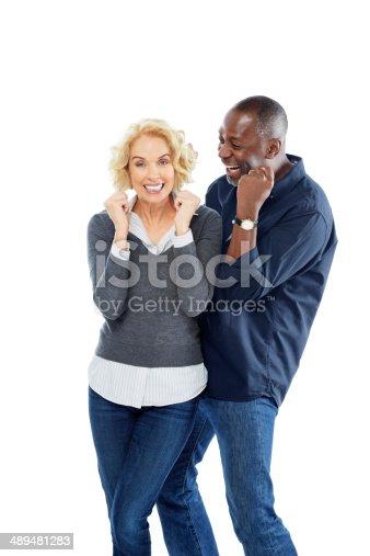 istock Ecstatic mature interracial couple celebrating success 489481283