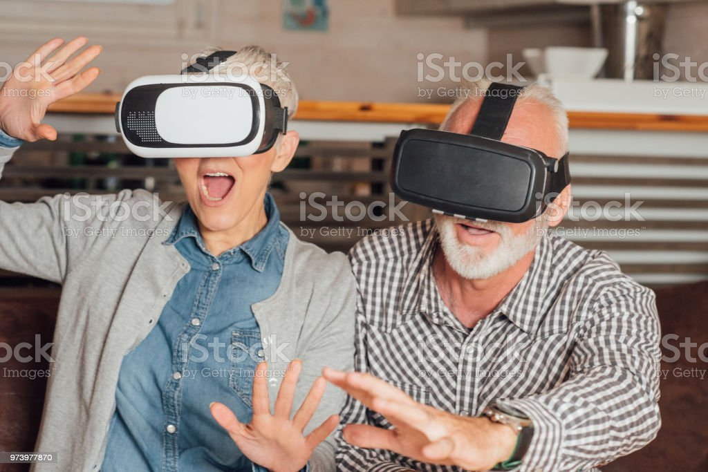 2370b12fbb6 Ecstatic old couple with virtual reality simulator royalty-free stock photo
