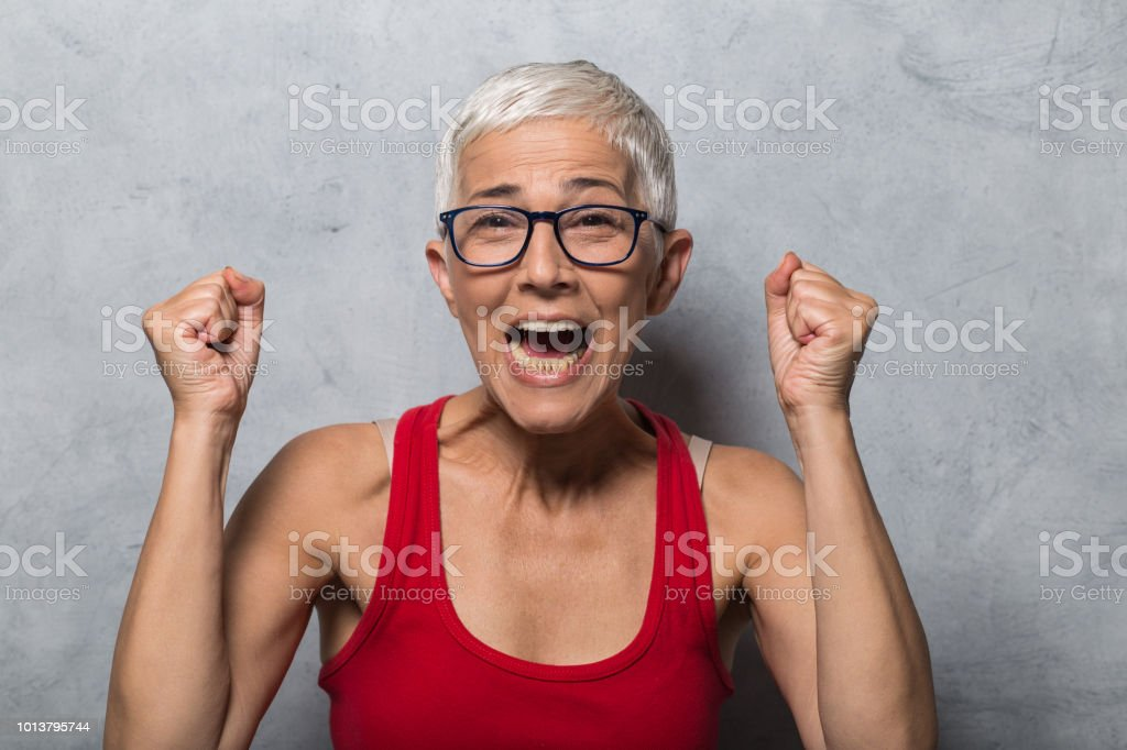 Mature woman shouting in excitement
