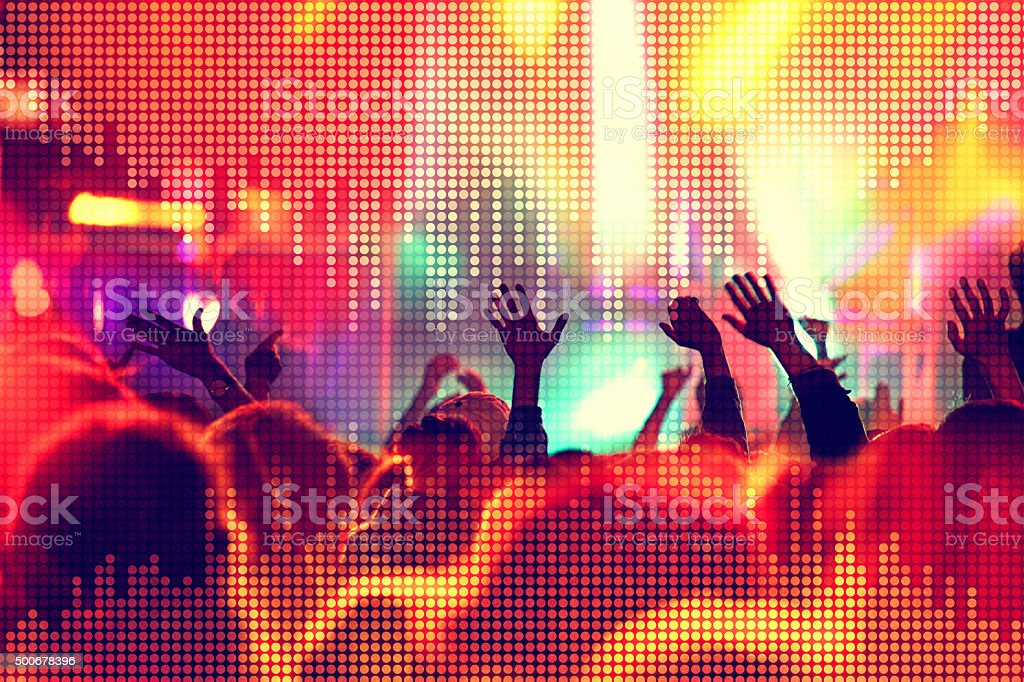 Ecstatic people at music concert with equalizer sound wave stock photo