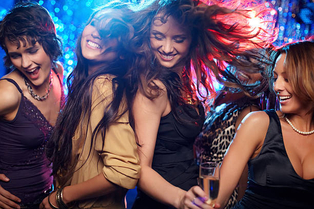 Ecstatic Young women having fun dancing at nightclub entertainment club stock pictures, royalty-free photos & images