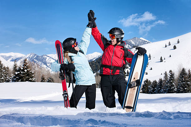 Ecstatic Skiers Giving High Five stock photo