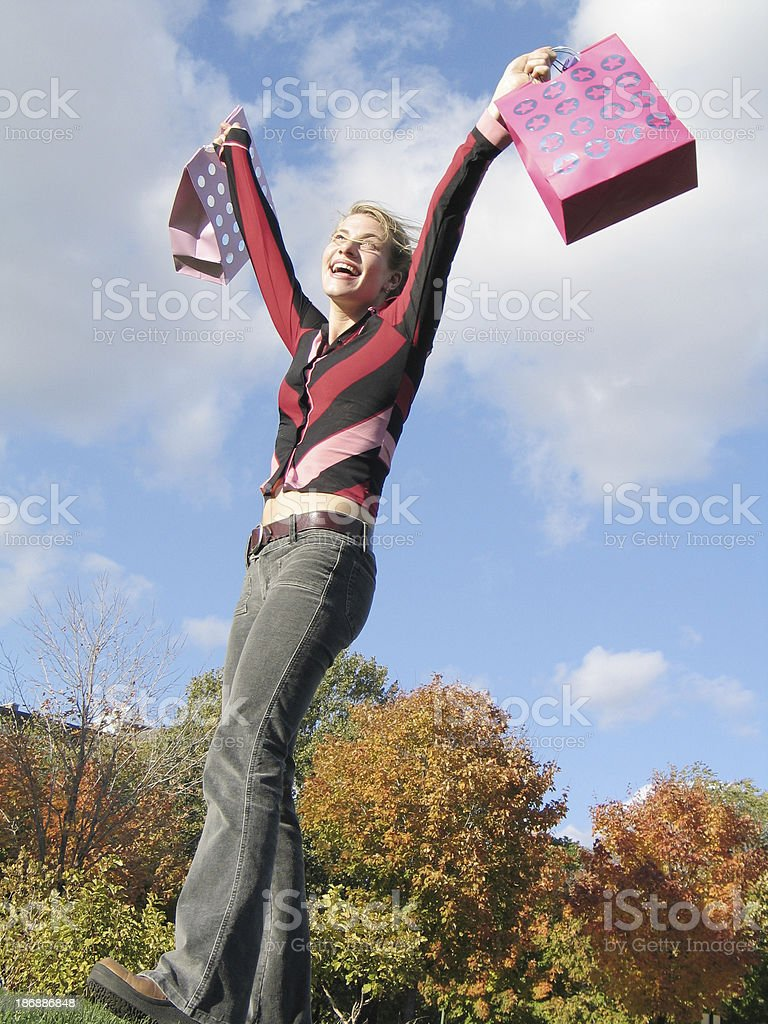 Ecstatic woman holding shopping bags royalty-free stock photo