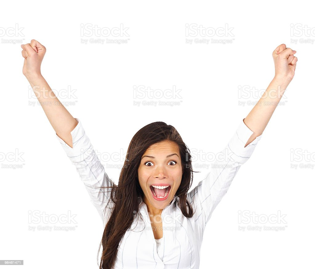 A ecstatic woman raising her arms royalty-free stock photo