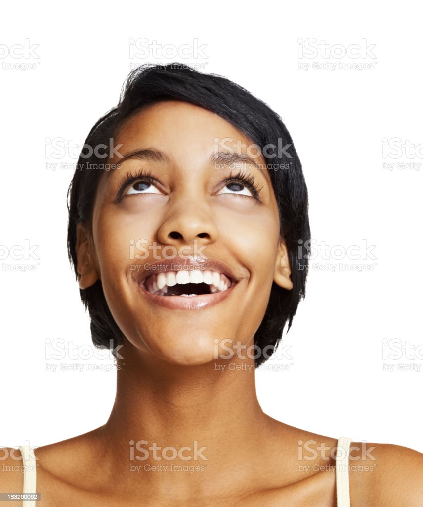Ecstatic woman smiling while looking up stock photo