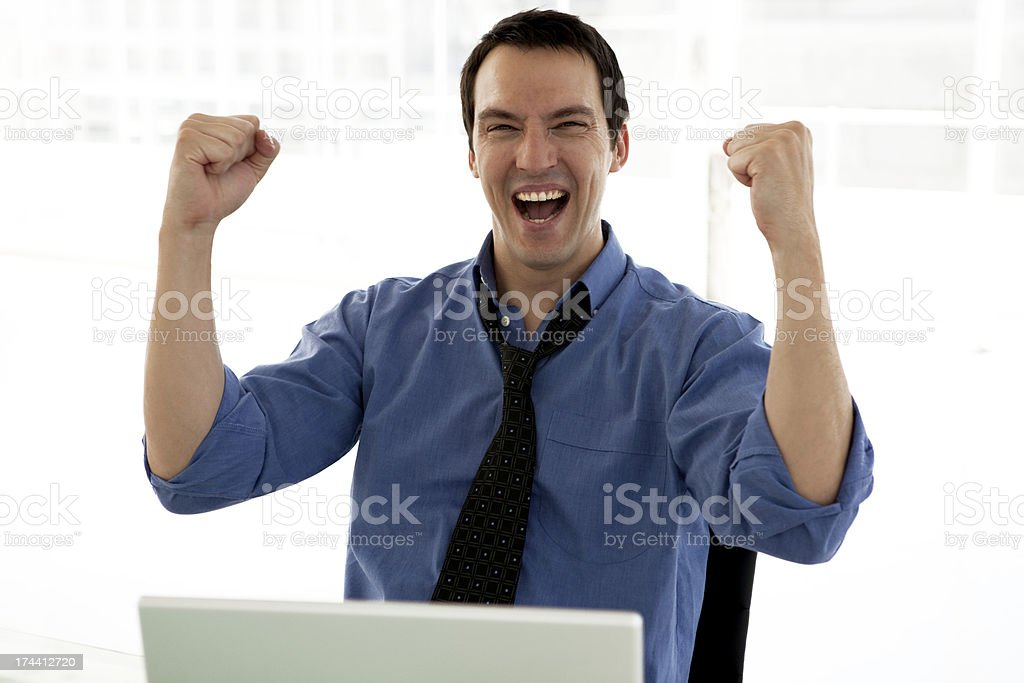 Ecstatic young businessman at workplace royalty-free stock photo