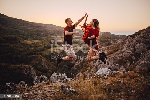 Ecstatic young campers jumping