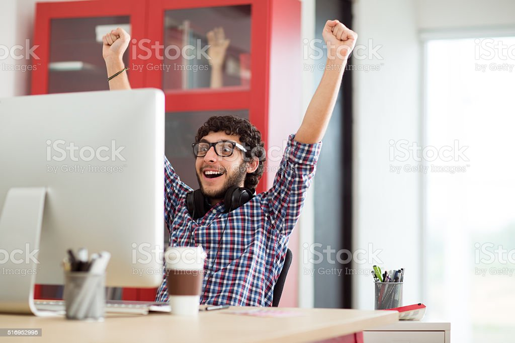 Ecstatic young graphic designer stock photo
