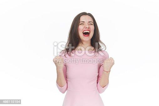 500150419istockphoto Ecstatic young woman celebrating 466115154
