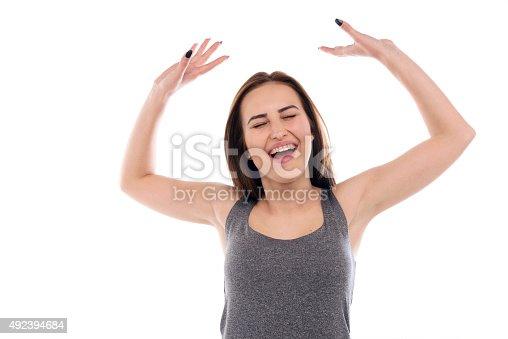 500150419istockphoto Ecstatic young woman celebrating 492394684