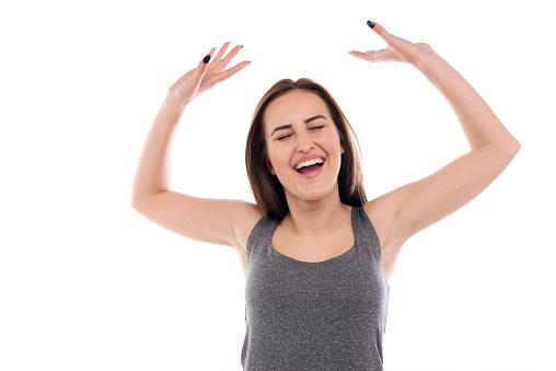 500150419 istock photo Ecstatic young woman celebrating 492394684