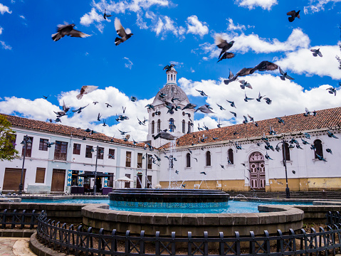 Ecuador, Cuenca city center, scenic view of San Sebastian church with fountain in foreground