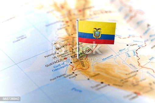 The flag of Ecuador pinned on the map. Horizontal orientation. Macro photography.