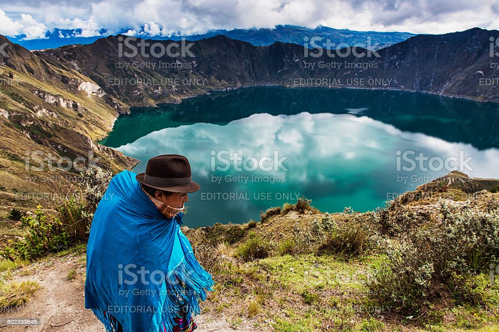 Ecuadorian woman walking near the Quilotoa Volcano stock photo