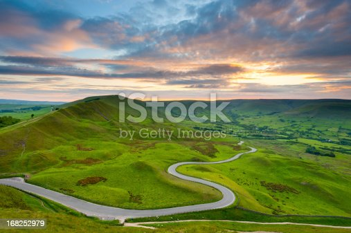 Looking down on a winding country road that descends into Edale Valley in the Peak District National Park. XL image size.