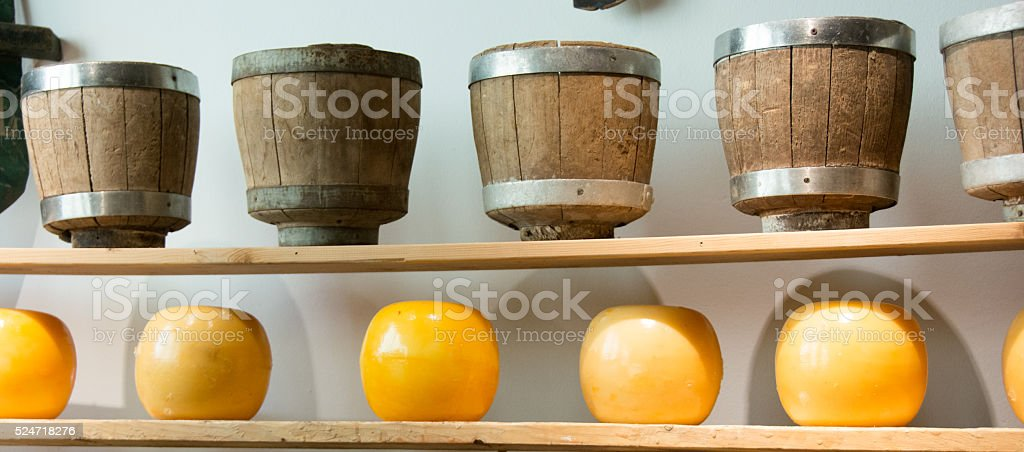 Edam cheese blocks on display in store with presses- Netherlands stock photo