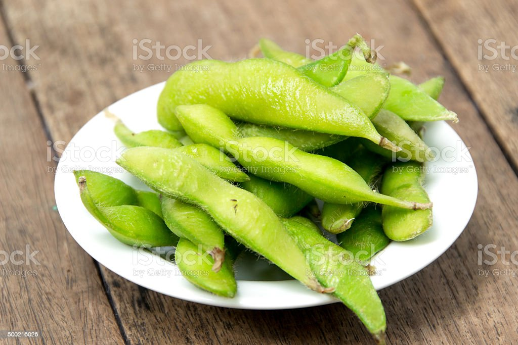 Edamame soy beans in white plate stock photo