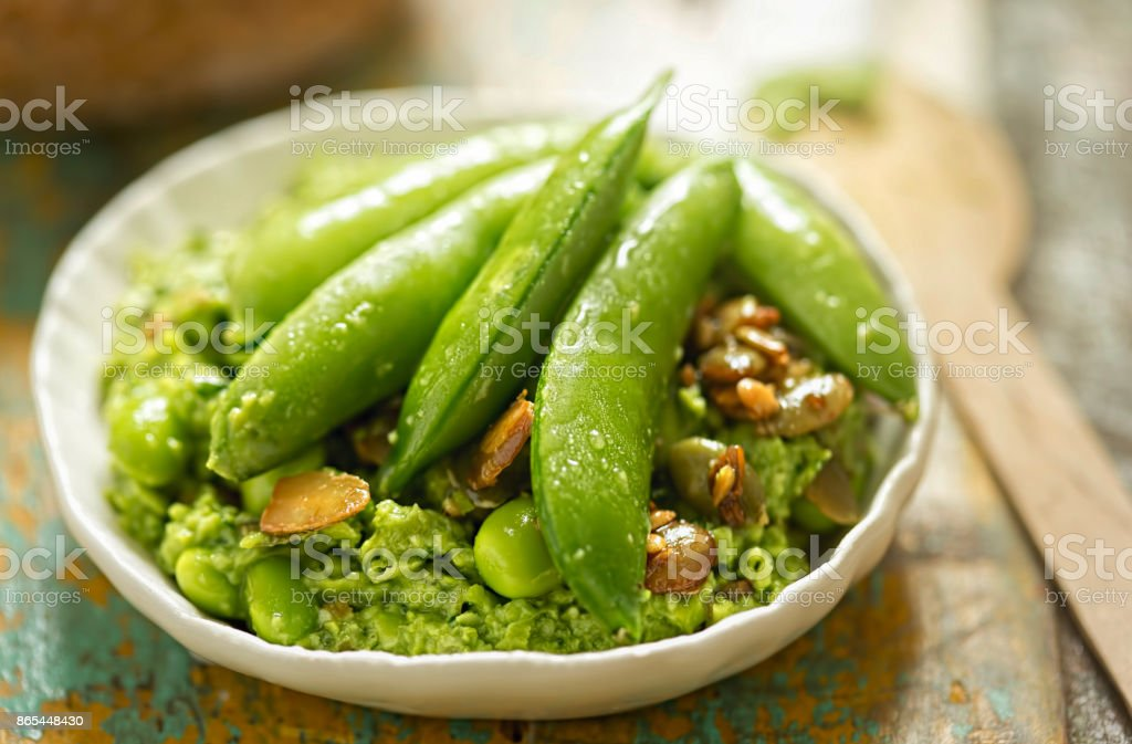 Edamame, soybeans, sugar snap peas, spinach, lemon roasted seeds with pea dip stock photo