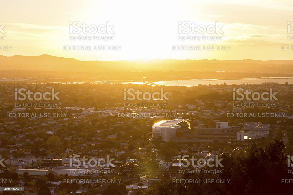 Eden Park and the Waitakere Ranges at sunset royalty-free stock photo