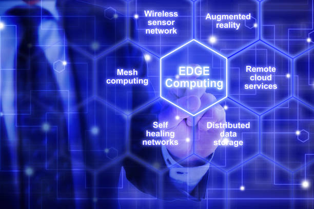 Edge computing hexagon grid with keywords from an IT expert IT expert in a blue suit touches a hexagon tile  with the words edge computing surrounded by specific keywords computer equipment stock pictures, royalty-free photos & images