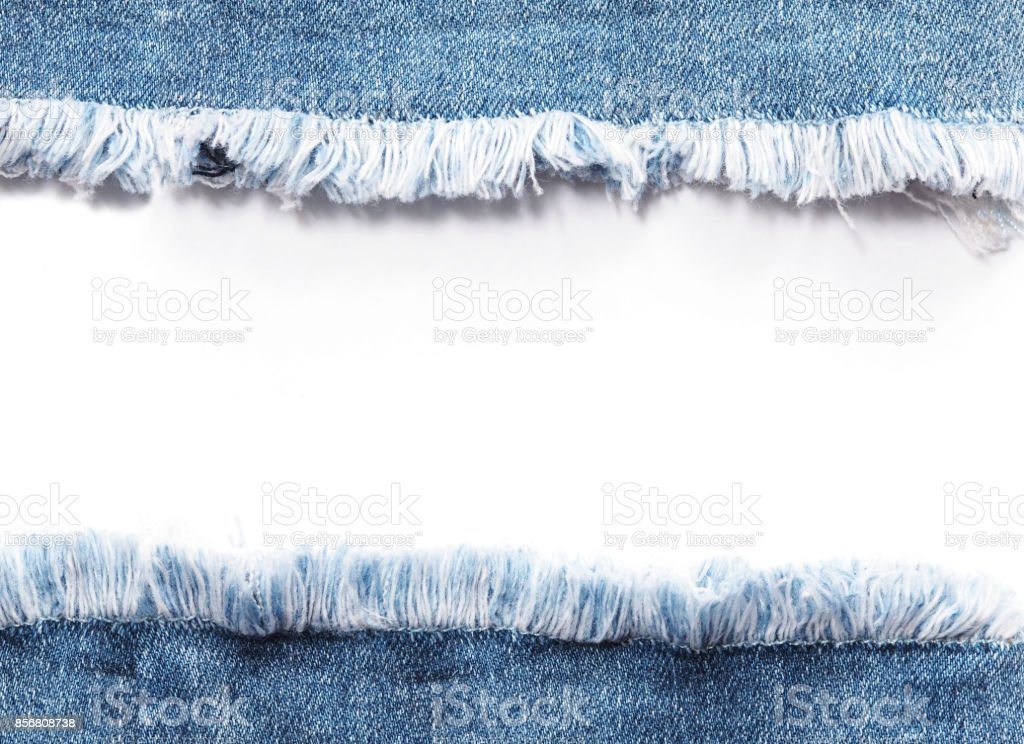Edge frame of blue denim jeans ripped destroyed torn over white background. stock photo