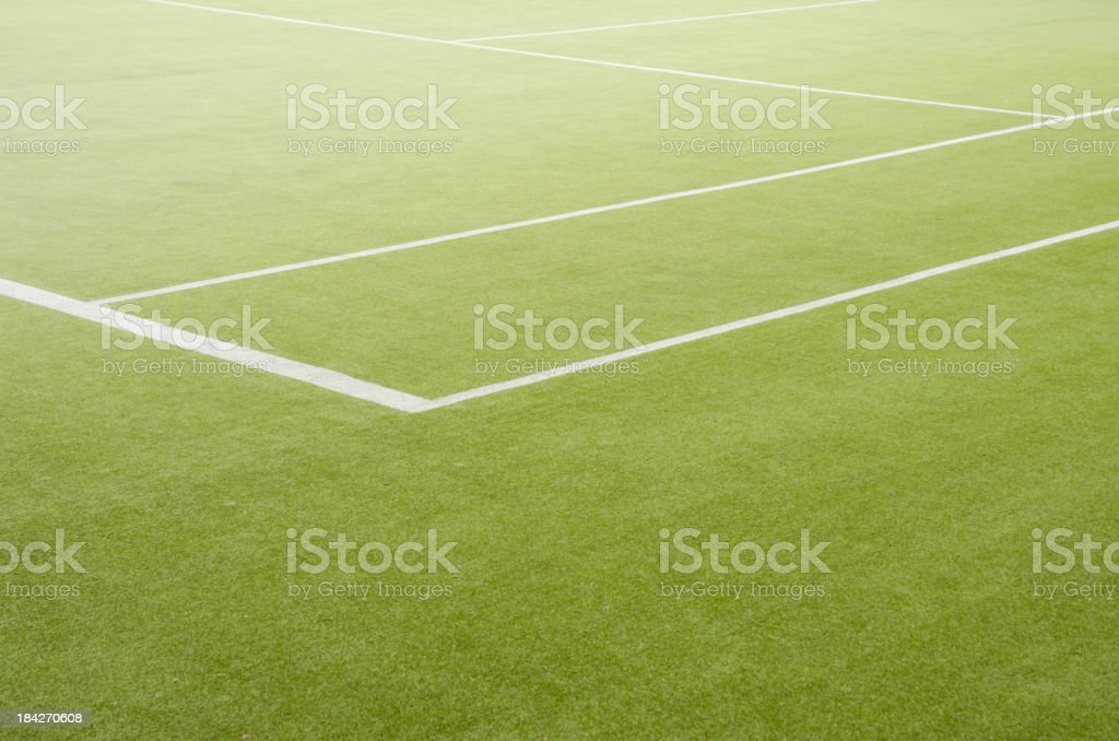 Edge of a grass tennis field stock photo