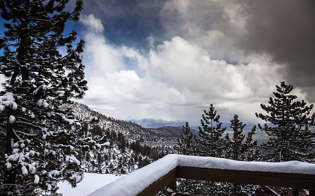 edge of a snowstorm at lake tahoe - lake tahoe winter stock-fotos und bilder