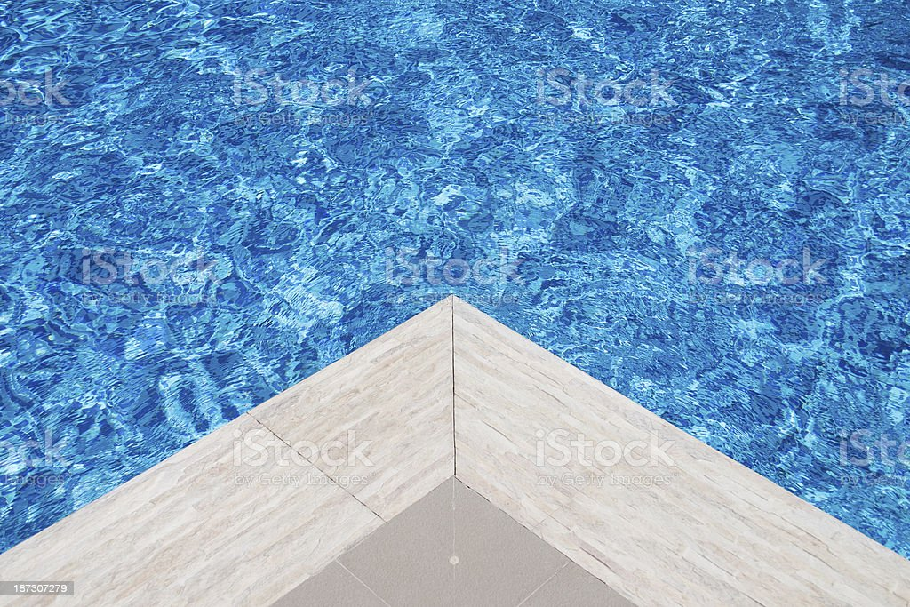 Edge of a swimming pool royalty-free stock photo