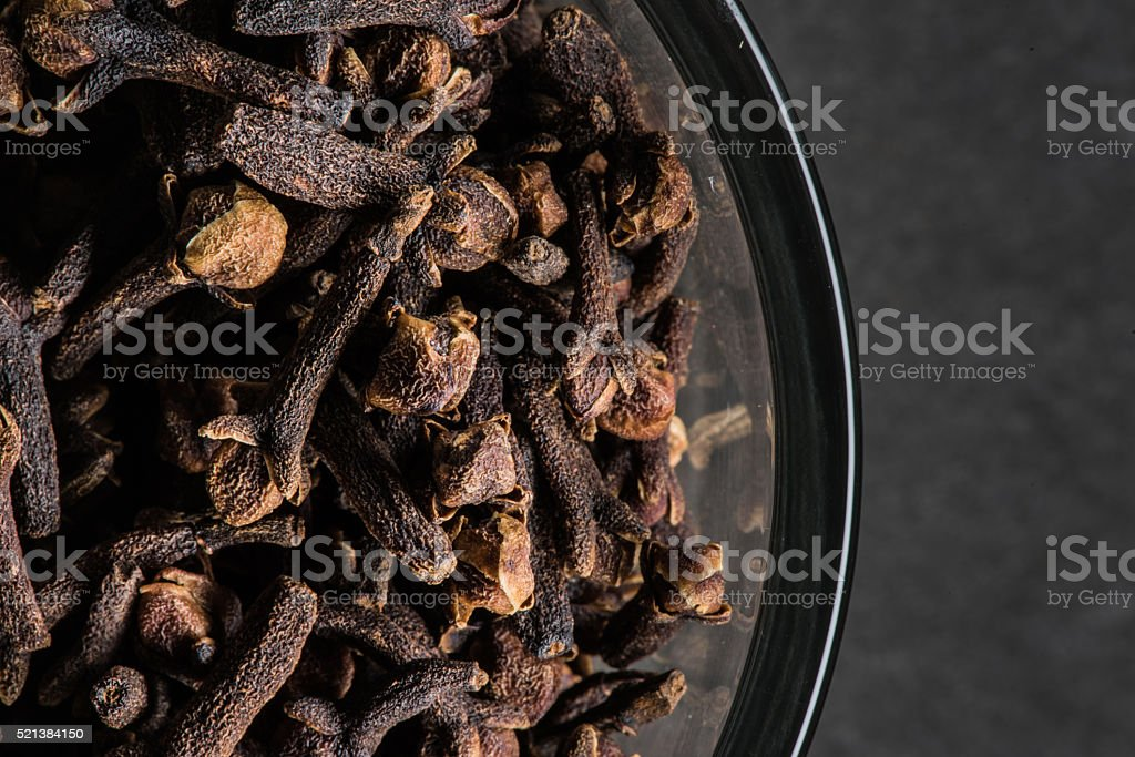 Edge of Bowl Cloves on Black Background stock photo