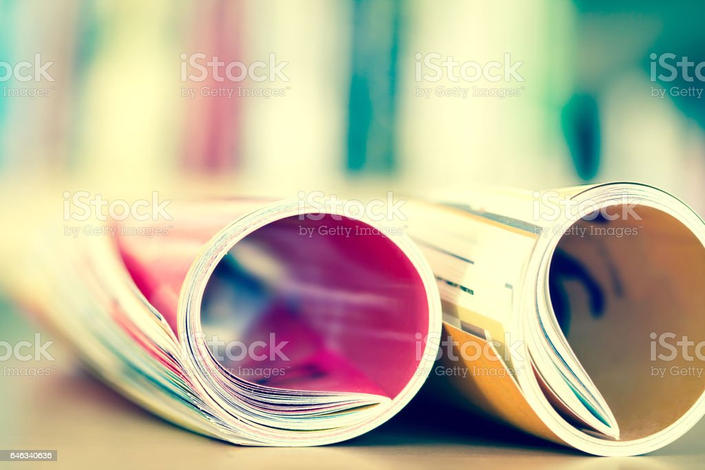 edge of colorful magazine stacking roll stock photo