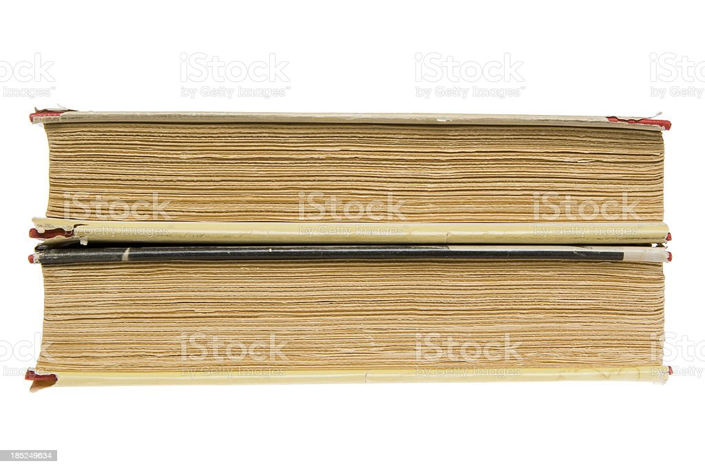 Edge view of two old hardcover books with rough pages royalty-free stock photo