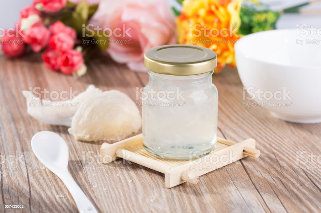 Edible Birdnest in transparent glass bottle,and useing modern technology for processing the products of edible bird's nest stock photo