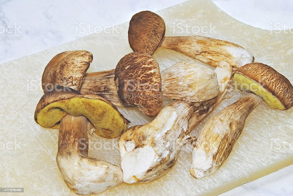 Edible Mushrooms on a Cutting Board stock photo