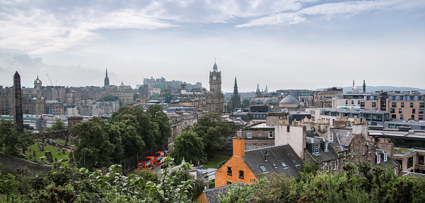 Edinburg, UK - August 23, 2021: Edinburg view from Calton hill. View include Edinburg castle, Balmoral hotel tower, and people relaxing in Claton hill