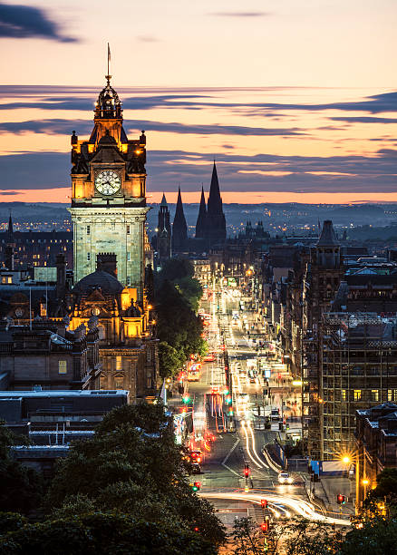 Edinburgh After Sunset A long exposure view at dusk along Princes Street in central Edinburgh, Scotland. princes street edinburgh stock pictures, royalty-free photos & images