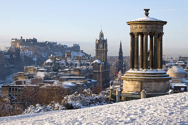 Edinburgh Castle and Cityscape in Winter Edinburgh City and Castle viewed from Calton Hill on a beautiful winter morning with the Dugald Stewart monument in the foreground and the castle, Scott monument and Balmoral clock tower in the background. edinburgh scotland stock pictures, royalty-free photos & images
