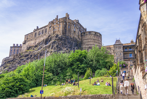 Edinburgh, Scotland - People enjoying warm sunny weather in Edinburgh, with a view of the Castle from the Grassmarket.