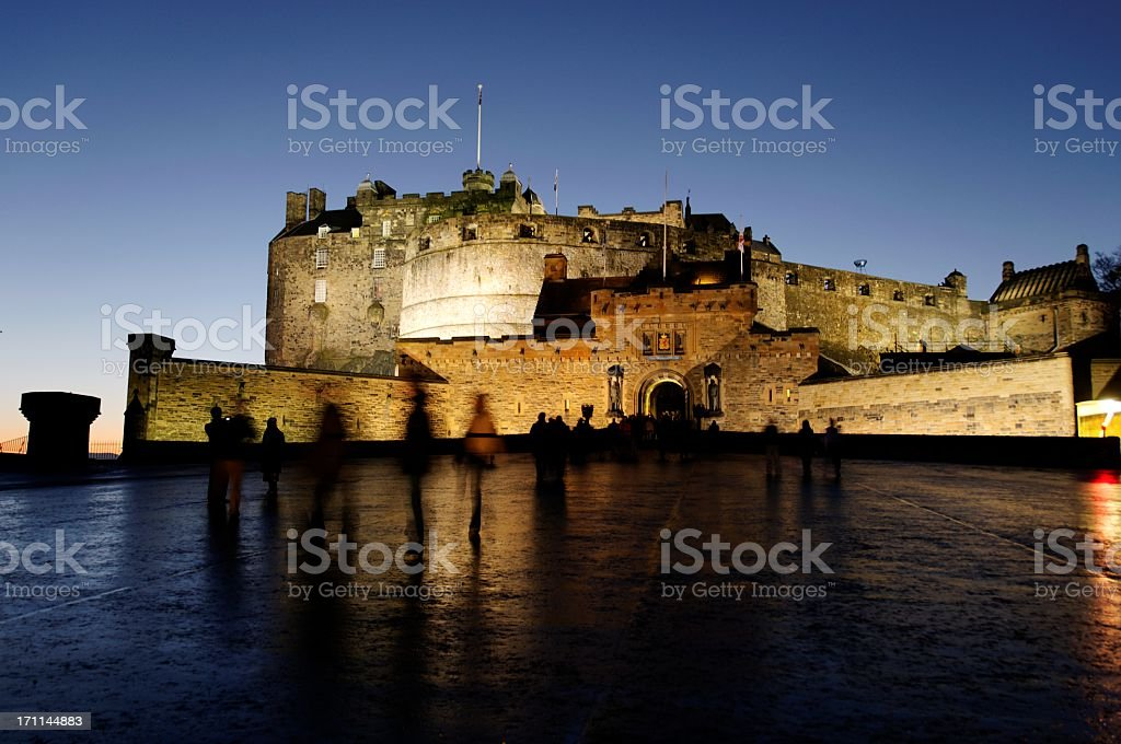 Edinburgh castle in the evening with lights stock photo