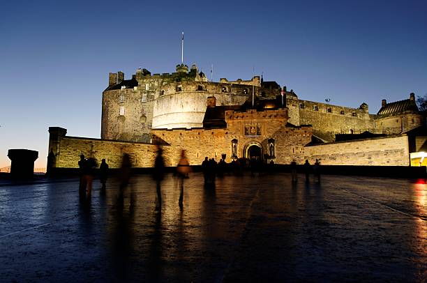 Edinburgh castle in the evening with lights Long exposure image of Edinburgh Castle in the evening. edinburgh scotland stock pictures, royalty-free photos & images