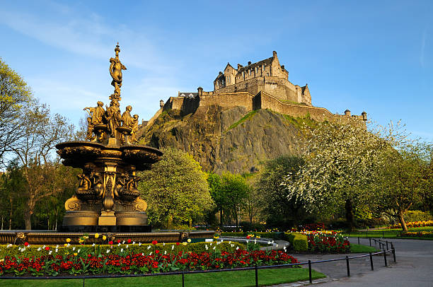 Edinburgh Castle A view of the iconic Edinburgh Castle, looking up from Princess Street gardens with the Ross fountain in the foreground. XL image size. princes street edinburgh stock pictures, royalty-free photos & images