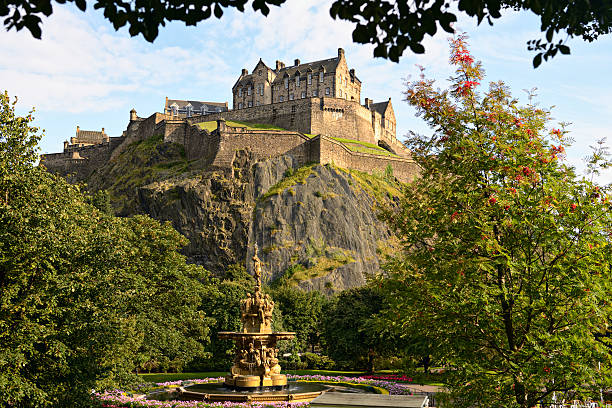 Edinburgh Castle, Scotland, from Princes Street Gardens, with Ross Fountain Edinburgh Castle, Scotland, from Princes Street Gardens, with the Ross Fountain in the foreground princes street edinburgh stock pictures, royalty-free photos & images