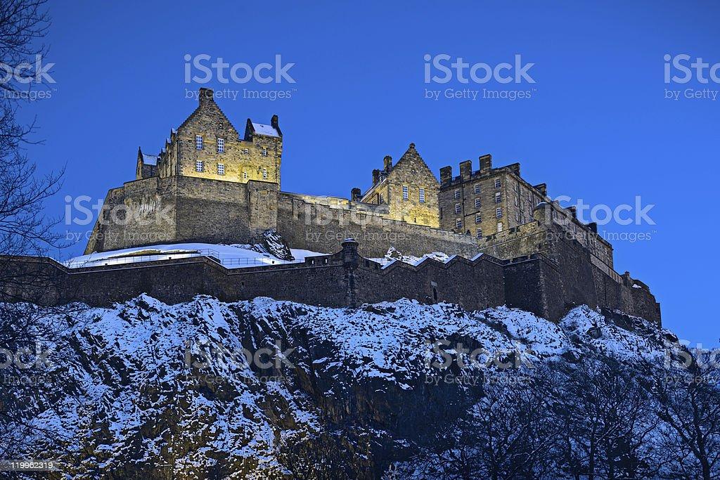 Edinburgh Castle, Scotland, UK, illuminated at dusk with winter snow stock photo