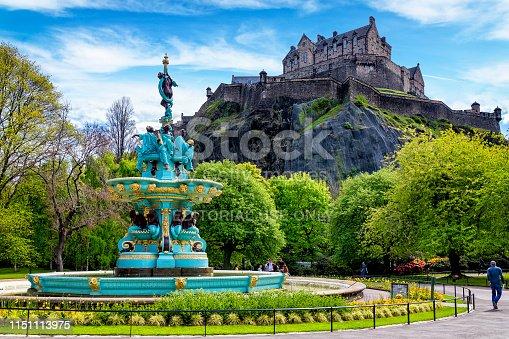 Edinburgh, United Kingdom - May 13, 2019:Restored Ross Fountain in Princes Street Gardens with Edinburgh Castle in the background. Edinburgh, Scotland, UK