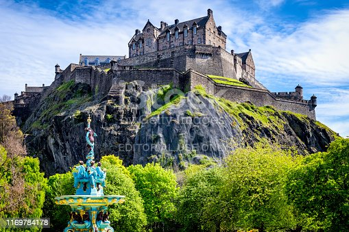 Edinburgh, United Kingdom - May 13, 2019:Restored Ross Fountain in Princes Street Gardens with Edinburgh Castle. Edinburgh, Scotland, UK