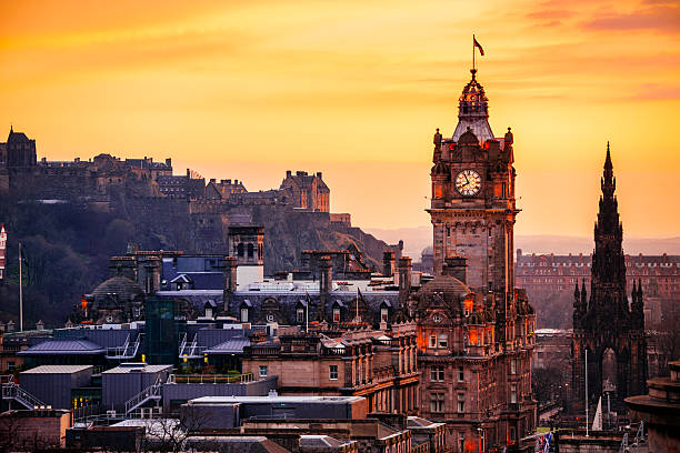 Edinburgh City Skyline At Sunset Looking over the buildings and roofs of Edinburgh Old Town towards Edinburgh Castle from Calton Hill as the sun sets. theasis stock pictures, royalty-free photos & images