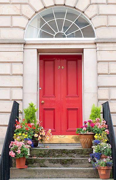 Edinburgh Door Entrance Flowers decorating a shared entrance to flats / apartments in Edinburgh's New Town front door stock pictures, royalty-free photos & images