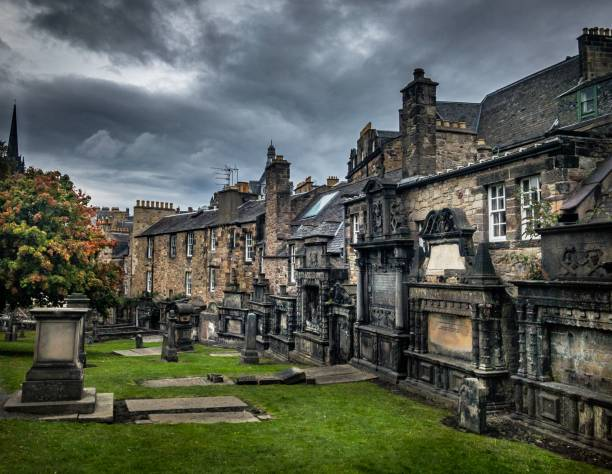 Edinburgh graveyard backing onto housing stock photo